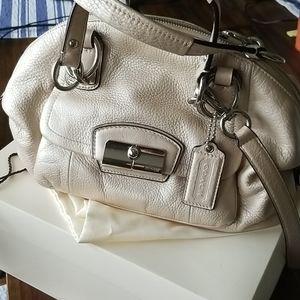 Coach leather  bag; full metallic gold